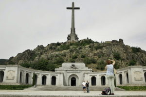 **  FILE  ** Spanish tourists are seen taking a snapshoot in this July 11, 2006 file photo in the Valle de Caidos (Valley of the Fallen), at the entrance of the basilica, carved into the rocks beneath a giant cross where the tomb of Spain's dictator General Francisco Franco lies. Parliament on Thursday began debating a law that seeks reparations for victims of the Spanish Civil war and the dictatorship of Gen. Francisco Franco. The bill, proposed by the Socialist government in July, would also ban symbols and references to the Franco regime in public buildings and asks local and regional governments to rename streets or plazas that are named after Franco or which refer to his regime. It also prohibits any political event at the Valley of the Fallen.(AP Photo/Bernat Armangue)